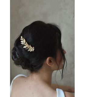 Bijoux mariage peigne à cheveux avec une feuille dorée pour le chignon de la mariée.