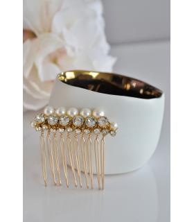Peigne Juliette pour le chignon de la mariée, composé de perles nacrées et de strass, afin d'agrémenter en toute discrétion votr
